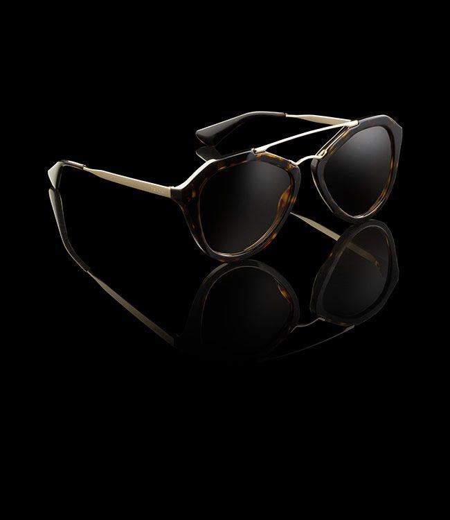 Prada  Sunglasses. Goth-style sport-glam tortoiseshell acetate frame with  retro 3c233c4b04