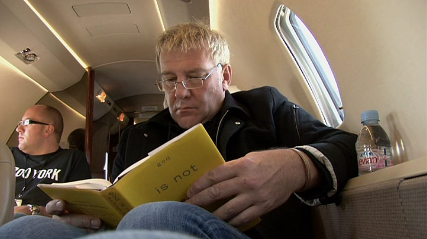 Alex Lifeson Reading God Is Not Great Http Catalog Nypl Org Record B17639621 S1 In The Documentary Rush Beyond The Lighted St Rush Concert Rush Music Rush