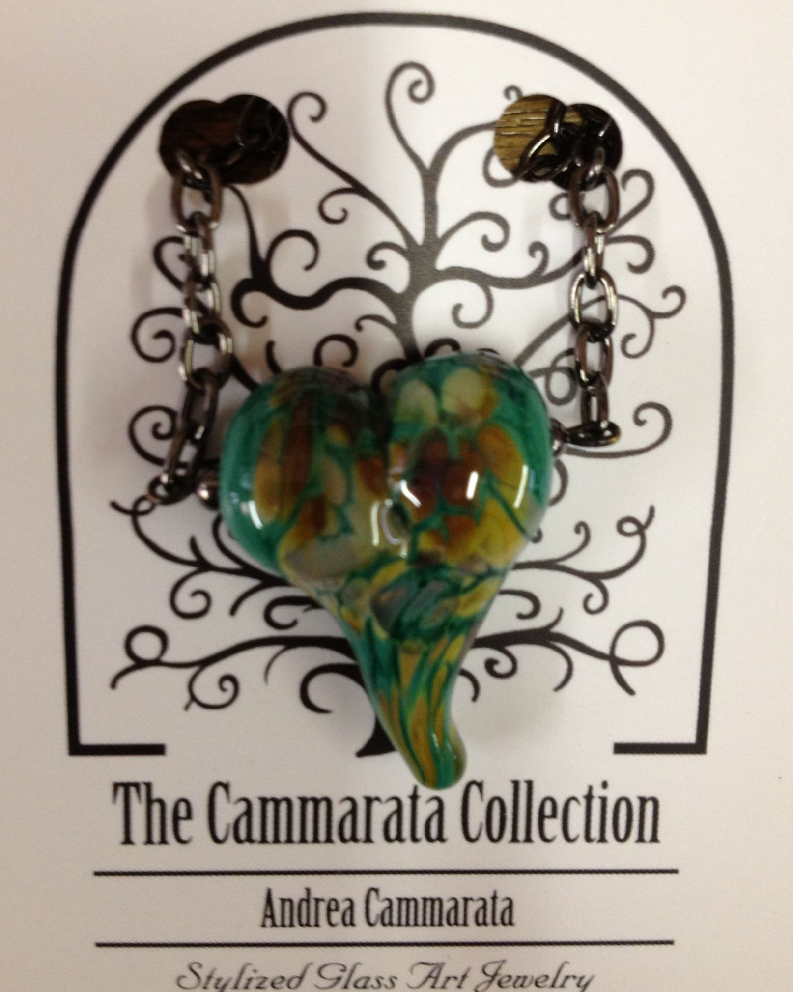 Glass heart necklace handmade by Andrea Cammarata .