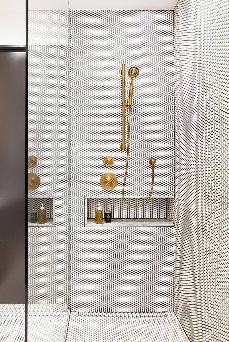 Photo of Penny Tiles And Brass Fixtures Set The Scene For This Bathroom Design