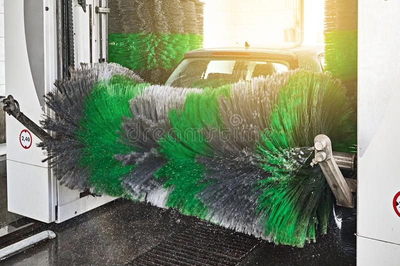 Automatic indoor car wash service in action modern