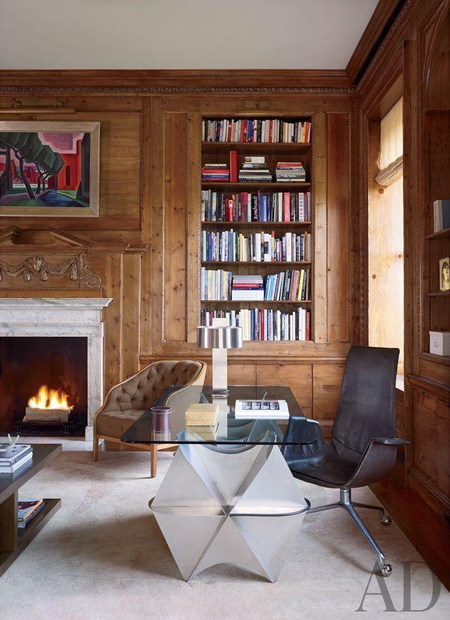 Shelton, Mindel & Assoc. shakes up a traditional paneled library.