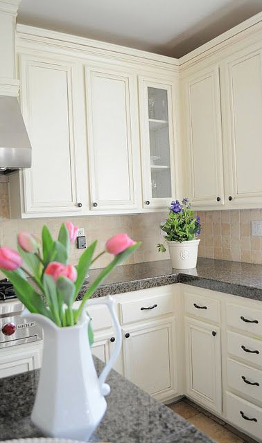 White Cupboards With Black Hardware And Chalkboards Granite Counter Tops Tile Back Splash Painting Oak Cabinets