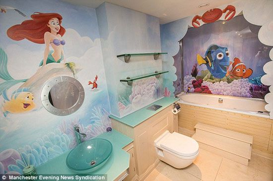 Sea Themed Bathroom For Kids With Ariel And Nemo Painted On The Wall Also  Tosca Sink And Wooden Floor