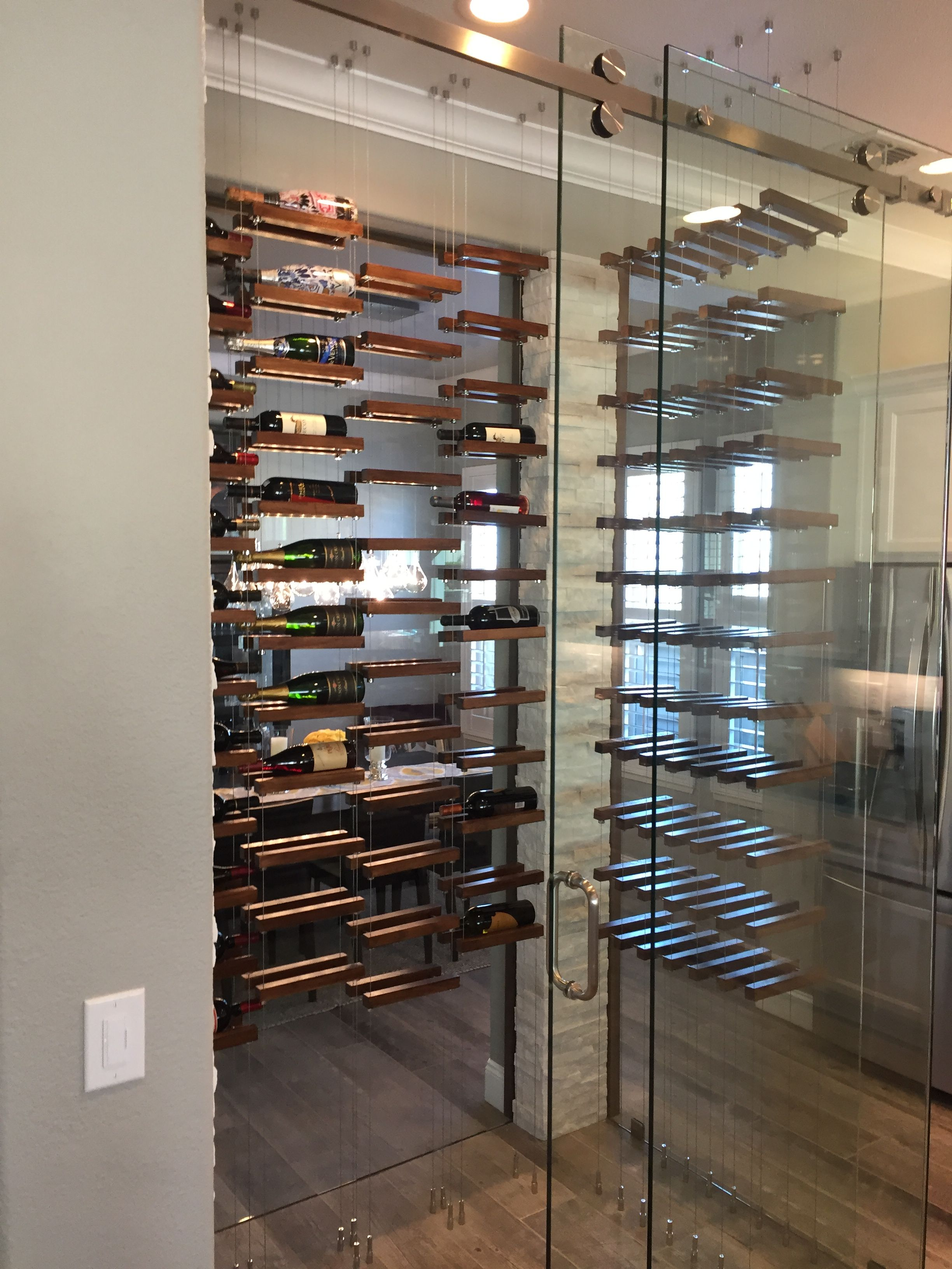 Pin By Buoyant Wine Storage Llc On Ceiling Mounted Buoyant Wine System Installs Wall Mounted Wine Rack Wine Wall Metal Patio Furniture