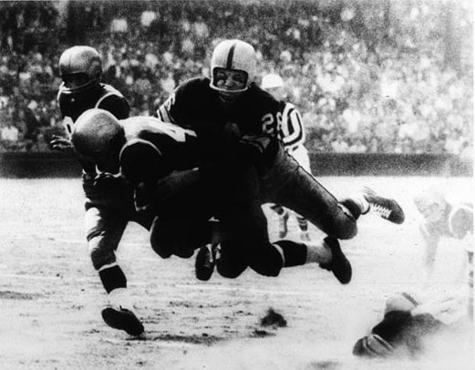 Photographer/Creator  Walter Stein  Collection  1956  Publisher  Associated Press  Caption/Description  Gary Glick, Pittsburgh Steeler halfback tackles Philadelphia Eagles Don Schaffer as he was in the open and headed for a touchdown in the second quarter of their game in Pittsburgh, PA.