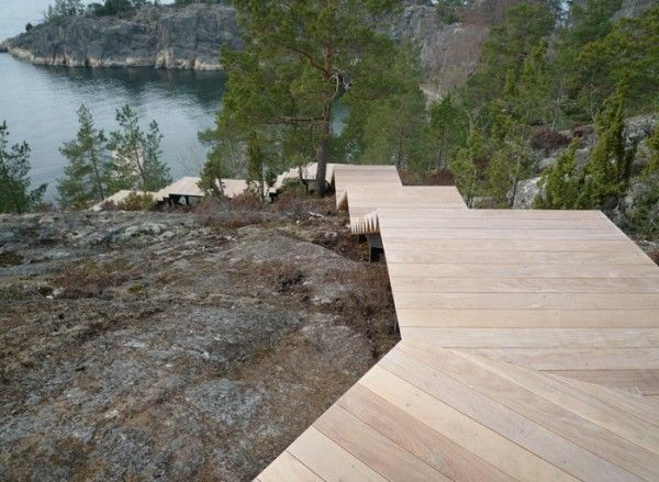 A steep winding staircase runs down the cliffside to the beach below