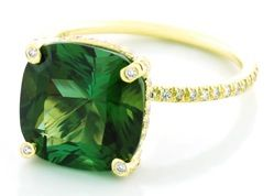 I had an emerald ring once, not like this one, but I had one.  I would love an emerald ring like this!