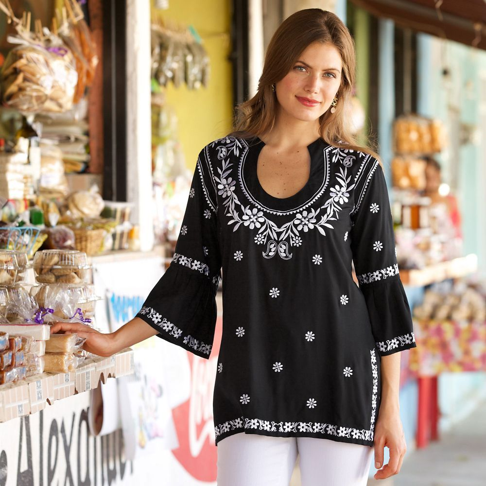 Floral embroidery gives this black-and-white tunic a hint of charm. Bandung