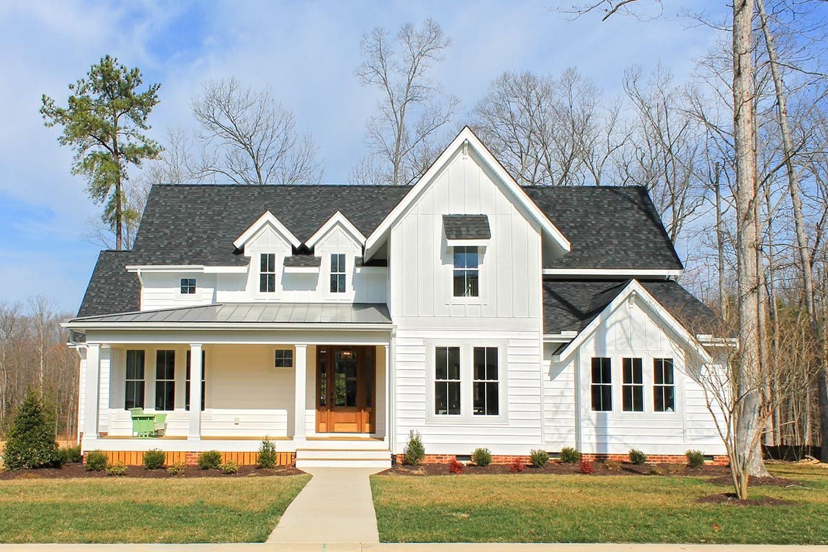 A sunroom and large open floor plan enhance this classic farmhouse style house plan that is exclusive to architectural designs with its great big country