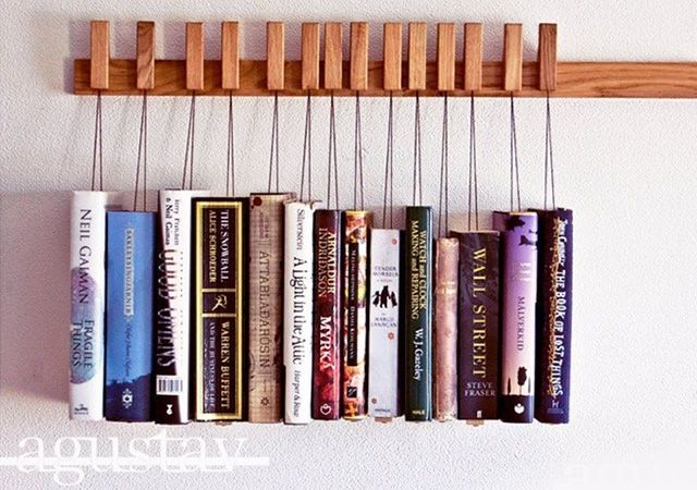 Who can resist cool book storage? Not me. This lovely project, called Book Rack, is by Danish studio Agustav. Pins/bookmarks hold your tomes attached to the wooden rail. The pins are removable and can be rearranged to meet your needs. The books rest on a small wooden plate so the pages stay intact. The plates can be moved back and forth on the bottom of the book to control the height of which the book hangs, making it possible to line different sized books up in a straight line.