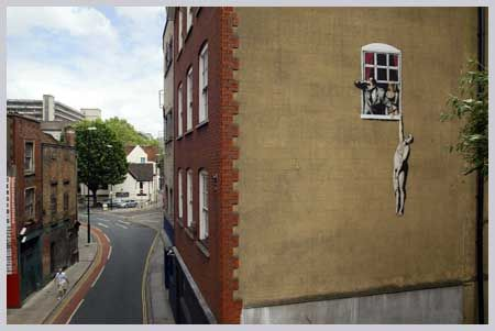 Naked Man Hanging From Window 2009
