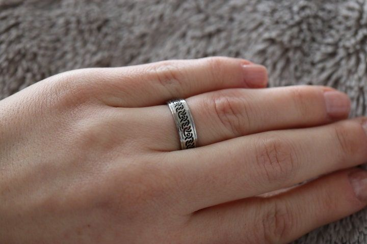 """""""This is beautiful stainless steel band with a Celtic Knot design. The band is perfect for showcasing the Celtic symbol of Eternity. The Eternal Knot has no visible end or beginning, which makes it impossible to untie and thus makes a great symbol of the bond of family, friends and loved ones. Since this ring is unisex and has a great variance in ring sizes, it is the perfect option for matching couples rings. We offer two rings bought together with a £5 discount. If you would like a set of two"""