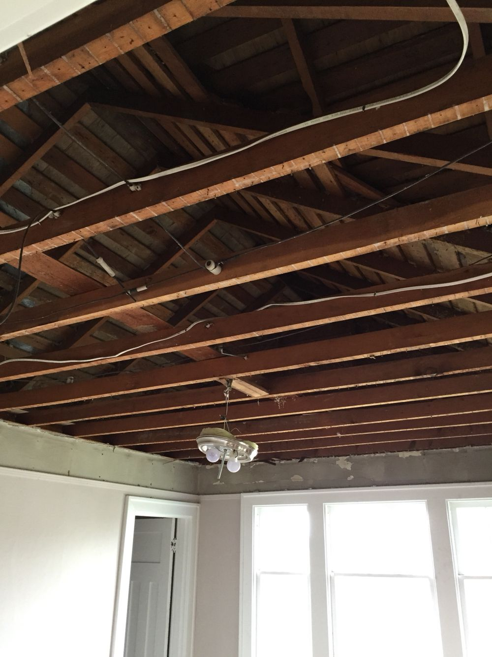 Replacing The Sagging Lath And Plaster Ceilings With Vaulted