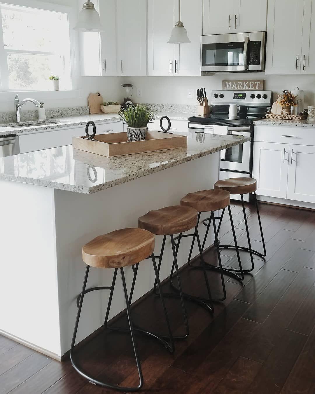 White kitchen cabinets. Granite countertops. Farmhouse kitchen ...