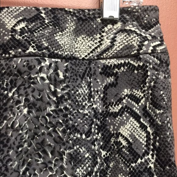 "Etcetera Cotton Snakeskin Pencil Skirt Stunning Etcetera snakeskin pencil skirt. The skirt features an invisible side zipper and the fabric is a great weight, 97% cotton, 3% spandex. This perfect condition pencil skirt is 22"" from top if waist to hem. Etcetera Skirts"