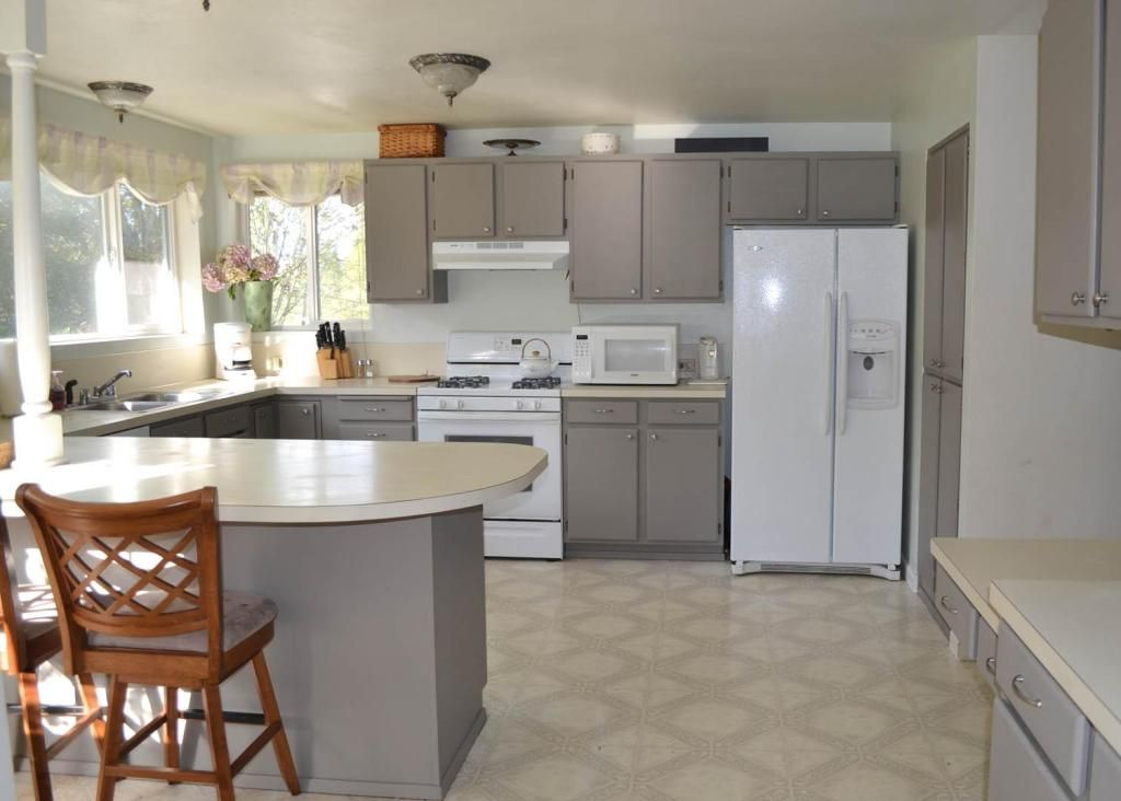 Grey Paint With White Cabinets Kitchen with white cabinets and