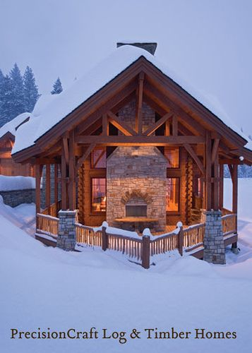 Snow covered exterior of a timber frame log home hybrid for A frame log house