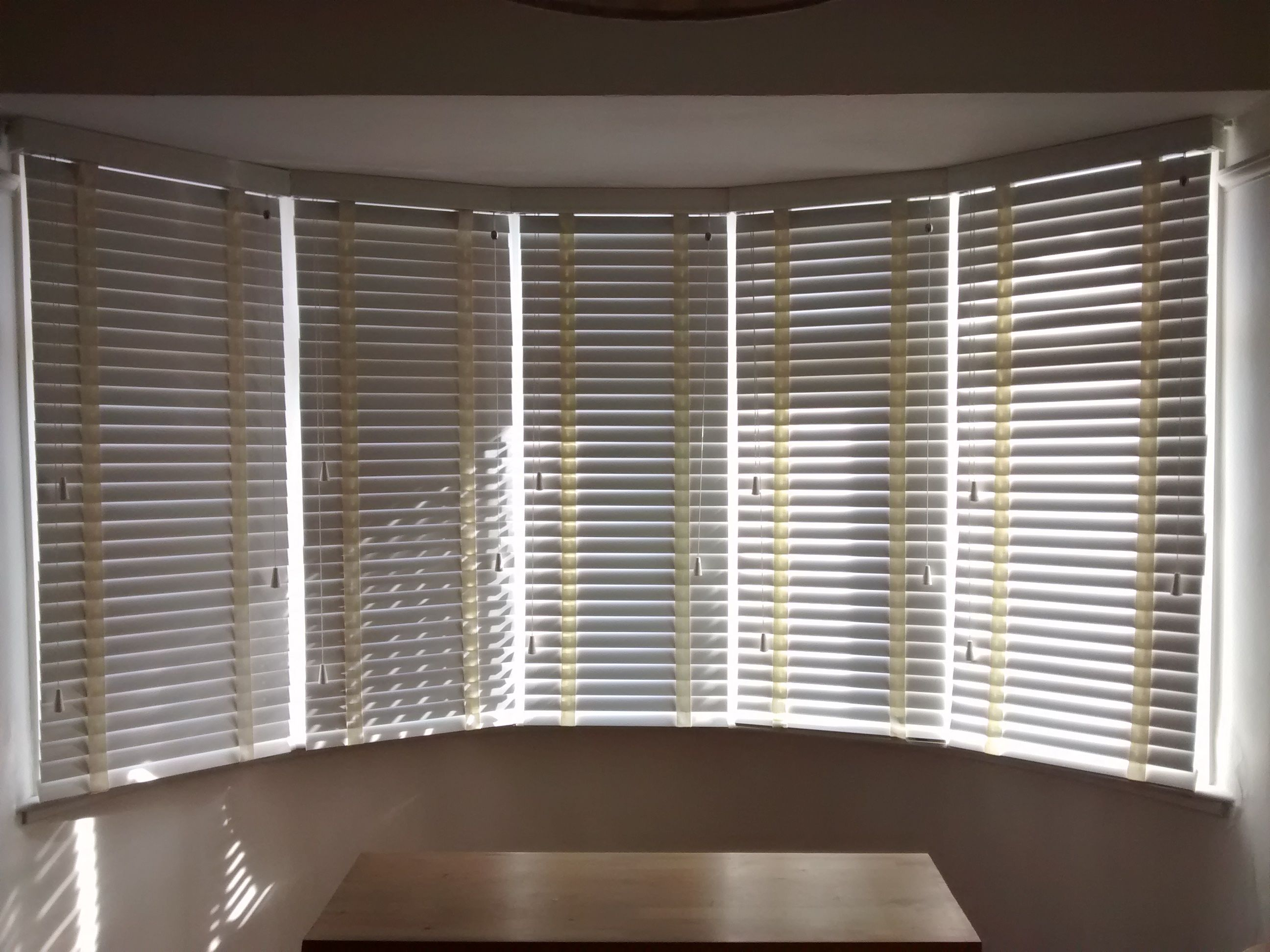 Bay window blinds - Wood Venetian Blinds In Chalk Colour Fitted To A 5 Sectioned Bay Window By The