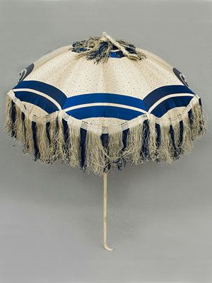 Left:  Silk parasol with rare royal blue color and carved ivory handle, c.1850.