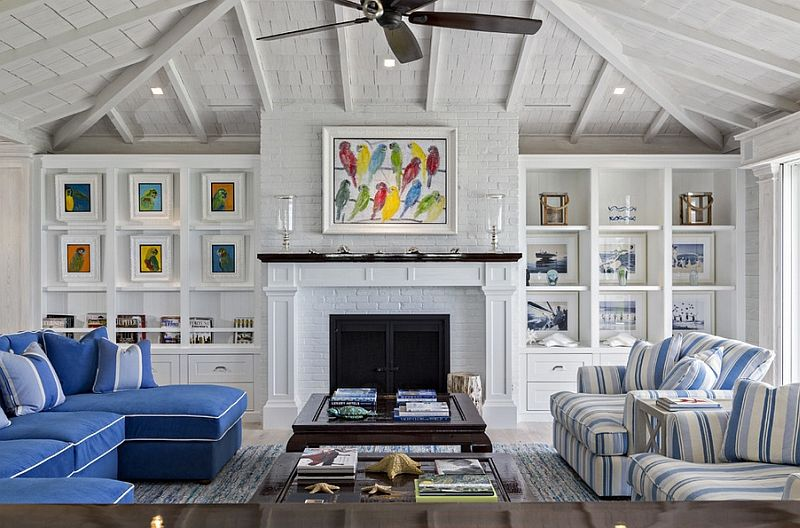 Beach Style Living Room With Open Beam Ceiling And Multi Colored Wall Art