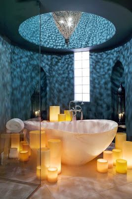 unique bathroom with a gorgeous stone bathtub, candleholders, and glamorous chandelier -- 6 Beautiful & Luxurious Bathrooms from Pinterest from Bathroom Bliss by Rotator Rod