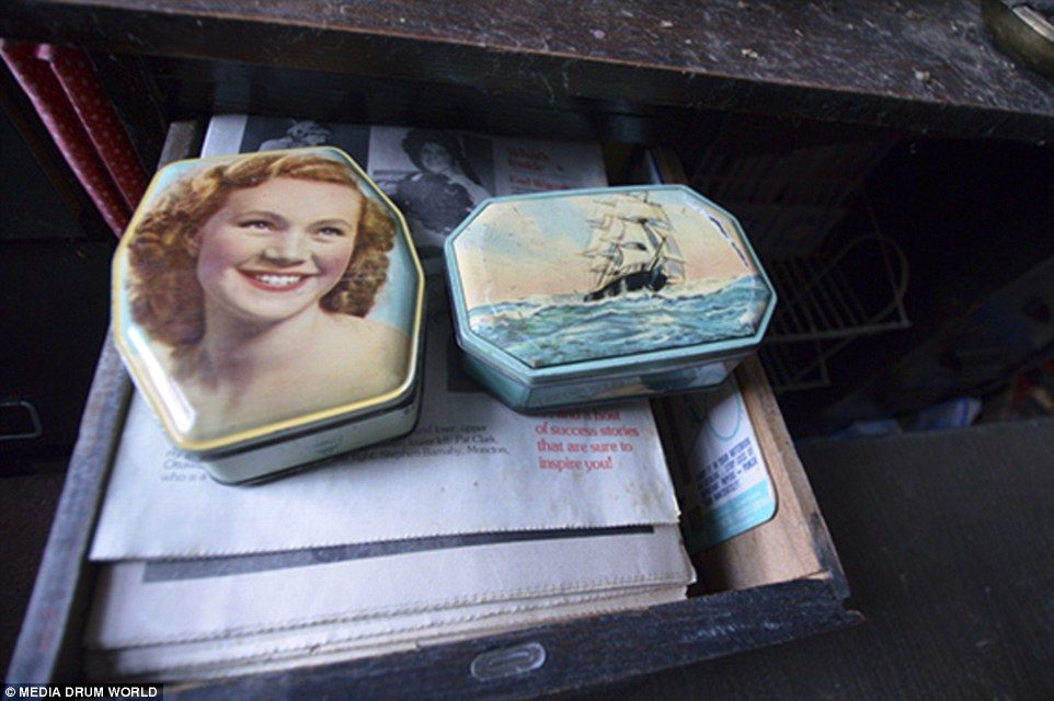 An open drawer shows illustrates tins and a pile of newspapers. Dave said: 'It was as though every single newspaper ever delivered to the house had been kept and placed into a box'
