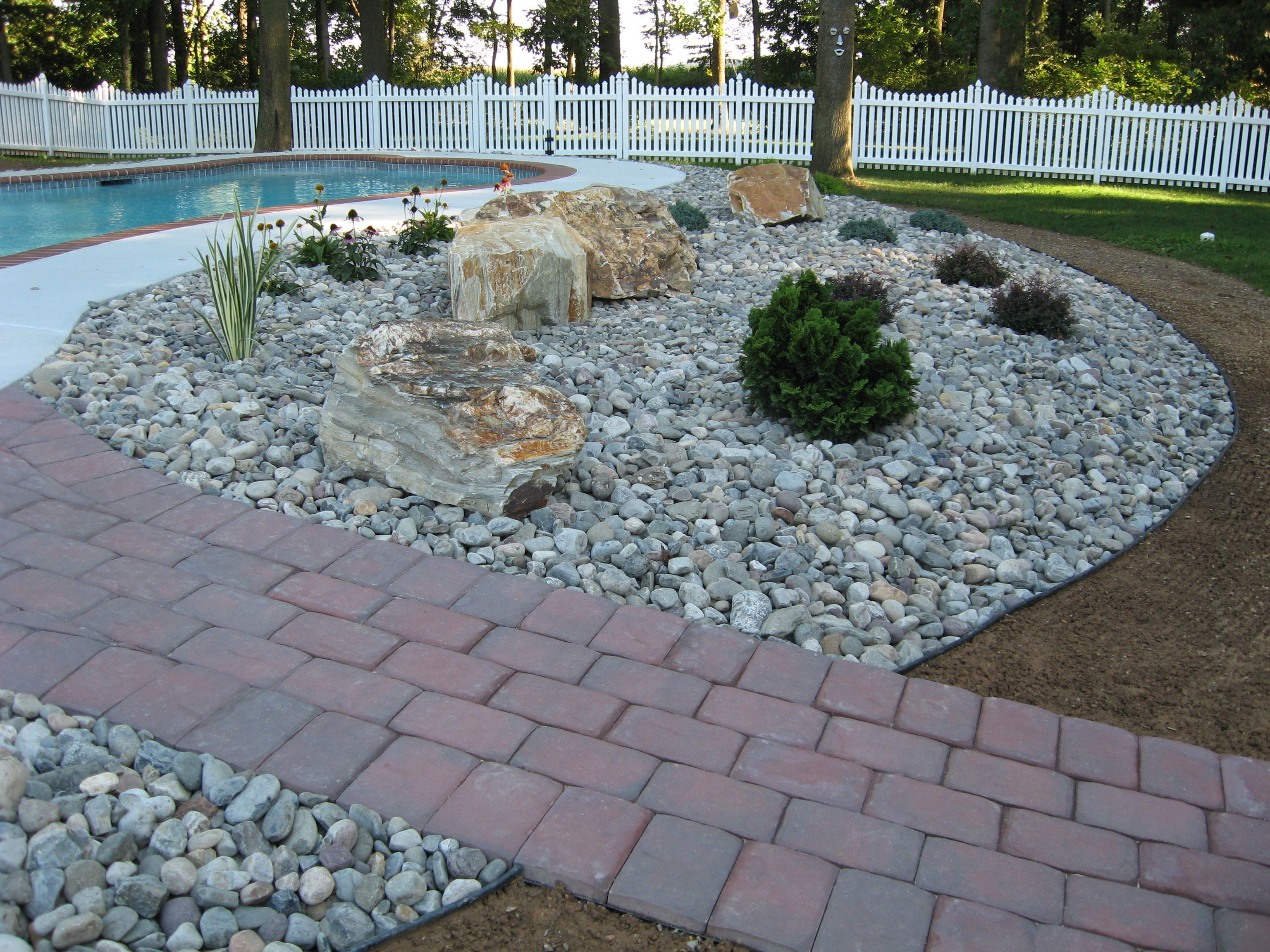 Delicieux Landscaping With Rocks And Stones | River Stones U0026 Boulders With Poolside  Plantings