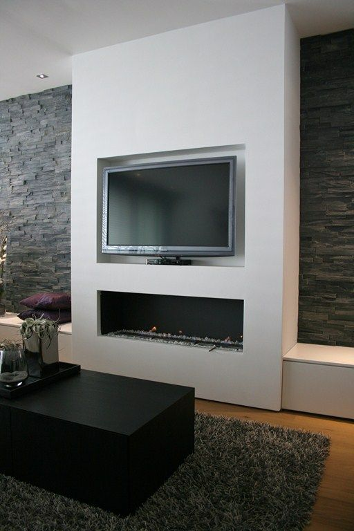 Recessed Tv Mounted Low Above Fireplace