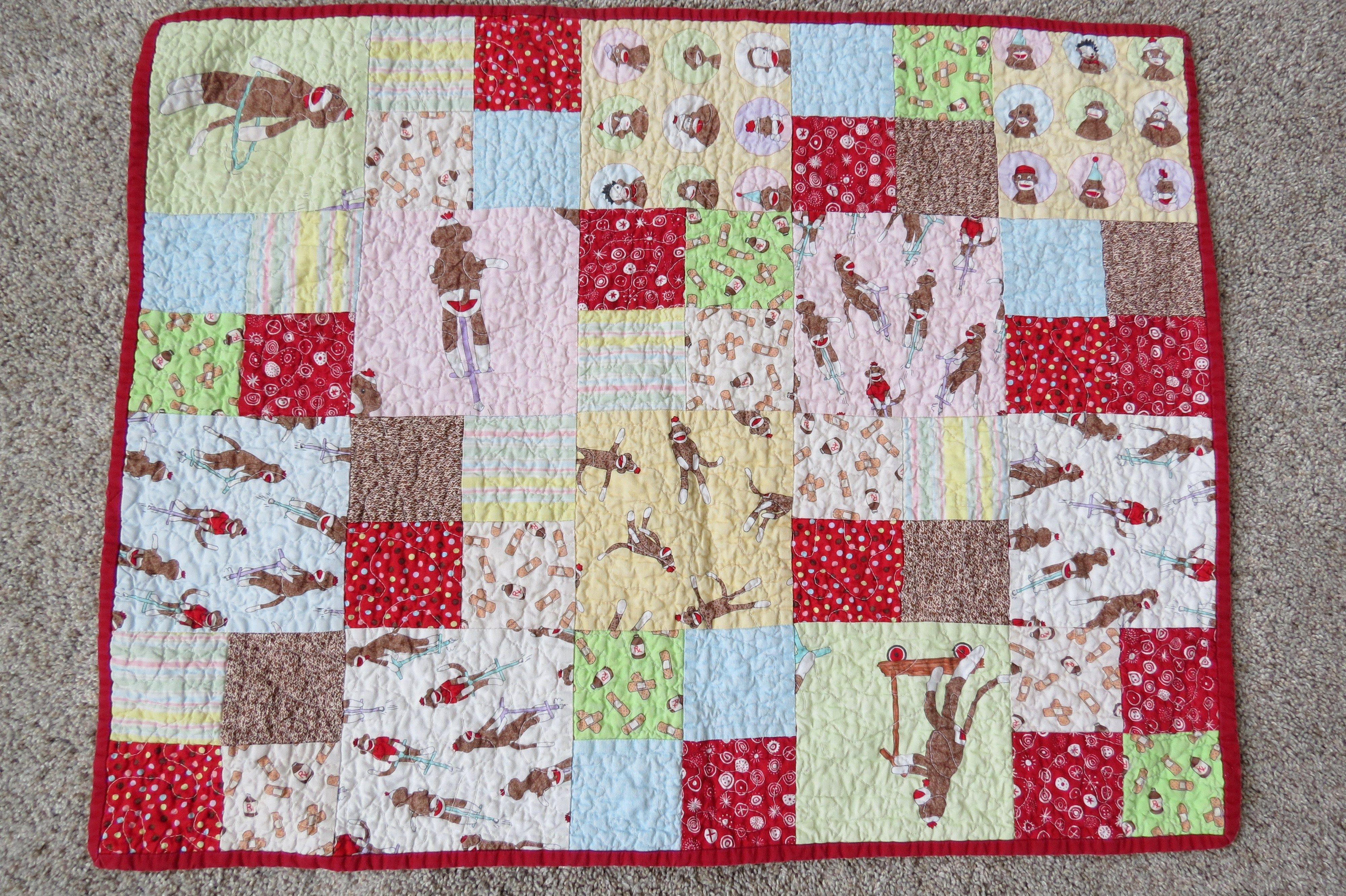 Skirt Fixation on the perfect baby quilt: a sock monkey quilt!