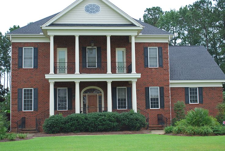 The Columns Of This Red Brick Home Contribute To Its Elegant Sophisticated Character And