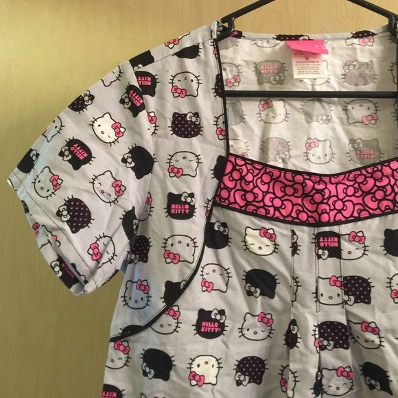 Hello Kitty Scrub Top Adorable brand new Hello Kitty scrub top. Tags still on. I love this, it's just too big for me. Size medium. Need to get rid of, so make an offer :) brand is Cherokee. Comment with questions! ☺️ Cherokee Tops Tees - Short Sleeve