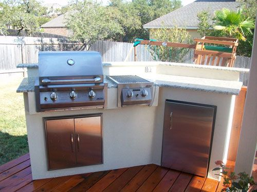small outdoor kitchen has the big 4: bbq, burner, fridge, and