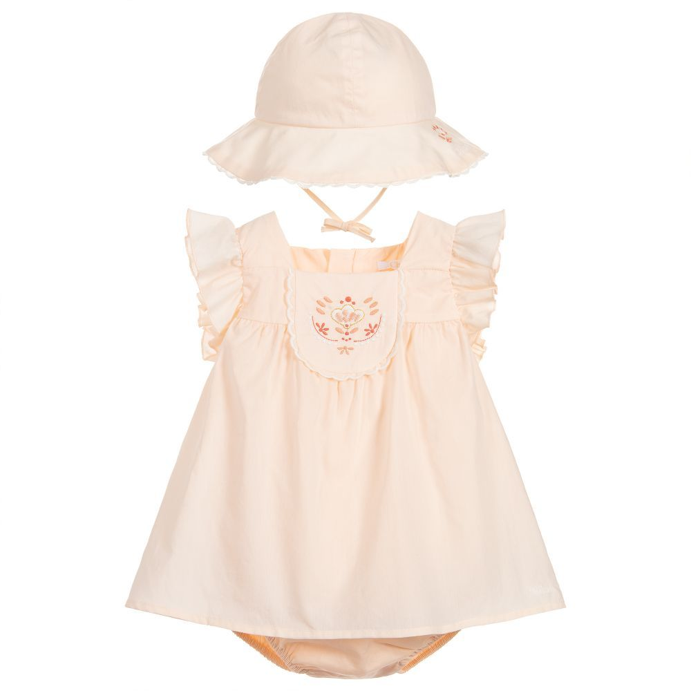 4f28a978a9c09 A pink cotton dress set for baby girls by Chloé. This lovely outfit has a  lightweight cotton dress, with attached bodysuit that fastens underneath  with ...