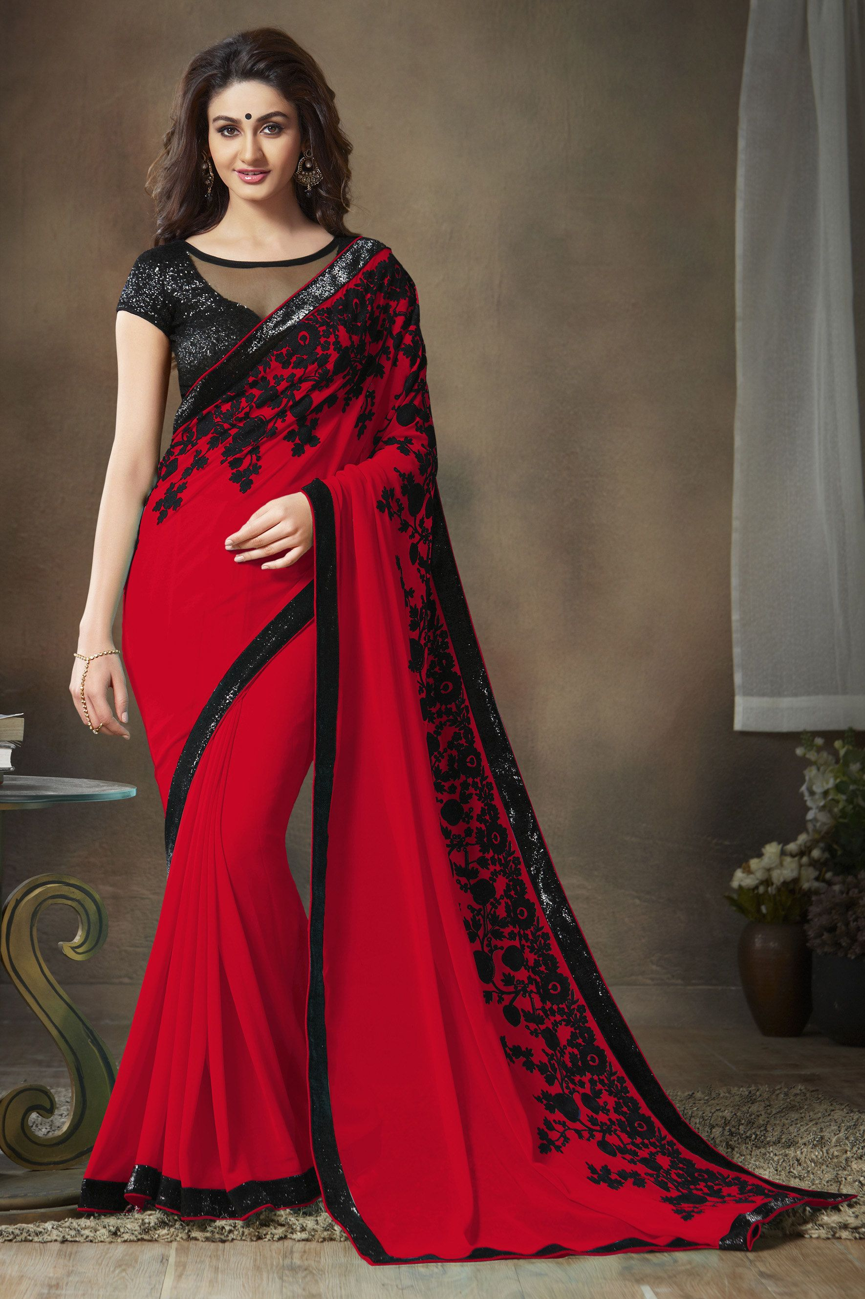 red saree with black floral border. Party wear sarees