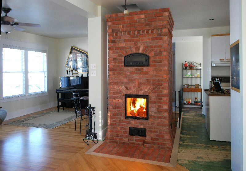 Rocket stove mass heater smallest rocket mass heater for Rocket stove inside fireplace