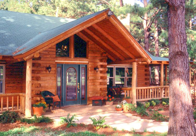 Green log home front door under front porch house for Log home porches