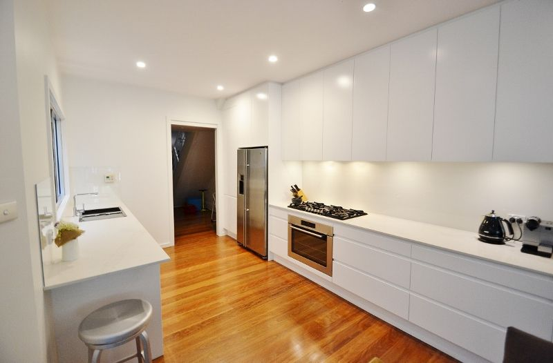 A Sleek New Kitchen In A Polyurethane Finish With A Handless Adorable Design New Kitchen Decorating Design