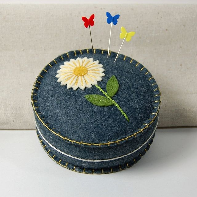 Daisy Pincushion  by TheBlueDaisy, via Flickr.  I've been needing a new pincushion and I have jeans to cut up, hum....  A gift for myself.