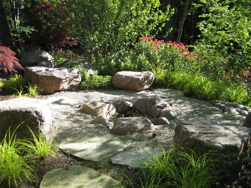 Outdoor firepit with boulders fire pit with granite boulder edge and seating with irregular - Mountain garden landscaping ideas ...