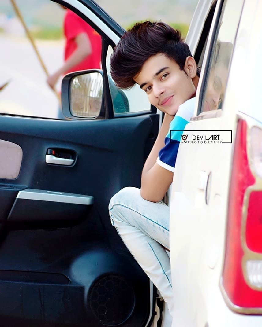 Image May Contain 1 Person Sitting And Car With Images Photoshoot Pose Boy Photography Poses For Men Cute Boys Images