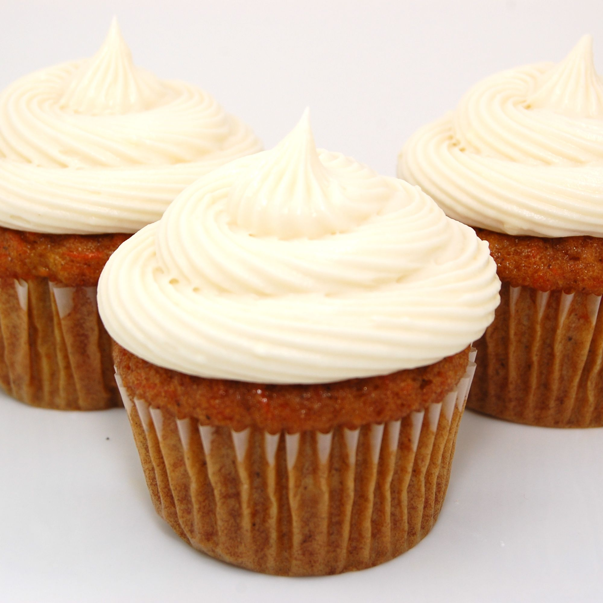 Carrot cake cupcakes with cream cheese frosting carrot