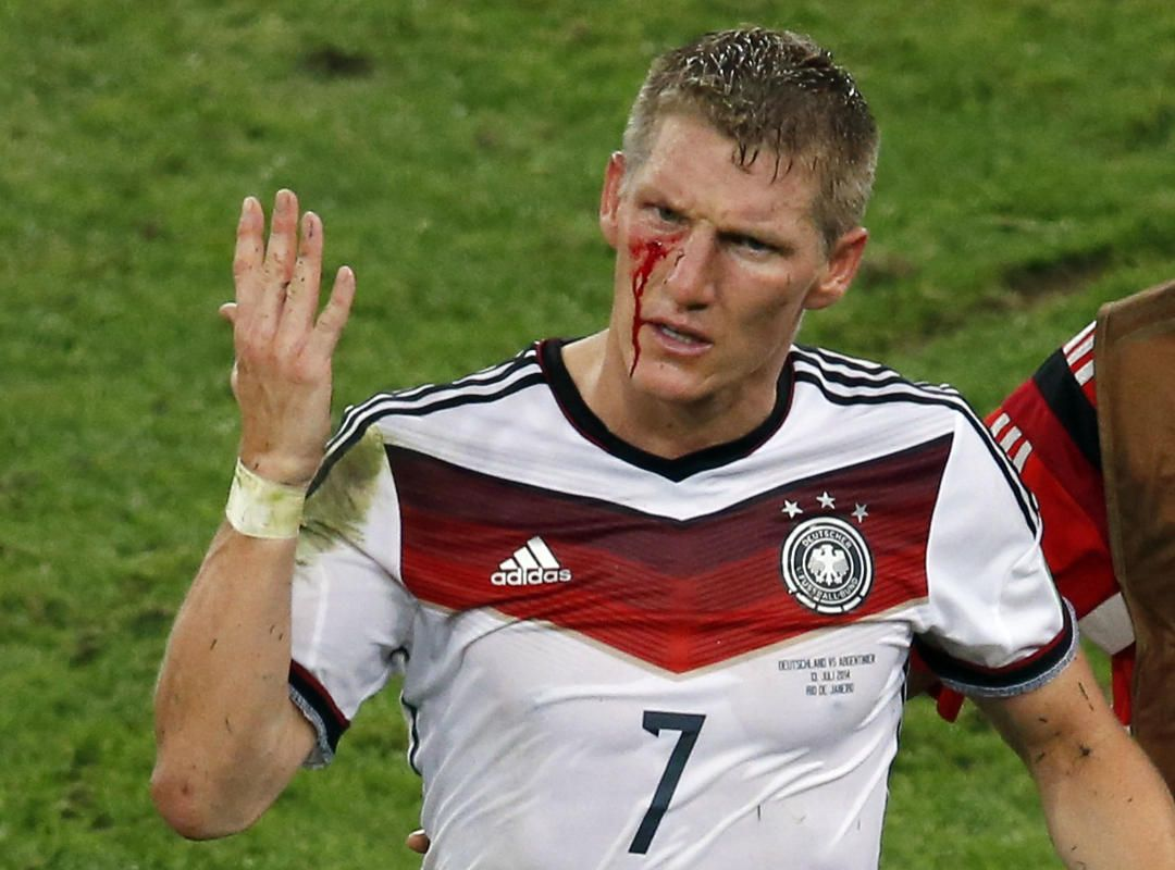 162d1c0d2 Germany s Bastian Schweinsteiger reacts as blood flows down his face after  he was fouled during their 2014 World Cup final against Argentina at the  Maracana ...