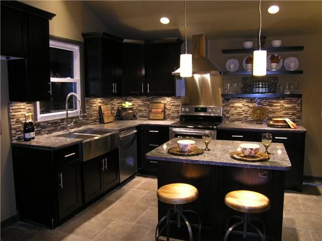 Light Colored Tile Floor, Dark Cabinets, Grey/tan Countertops U0026 Backsplash