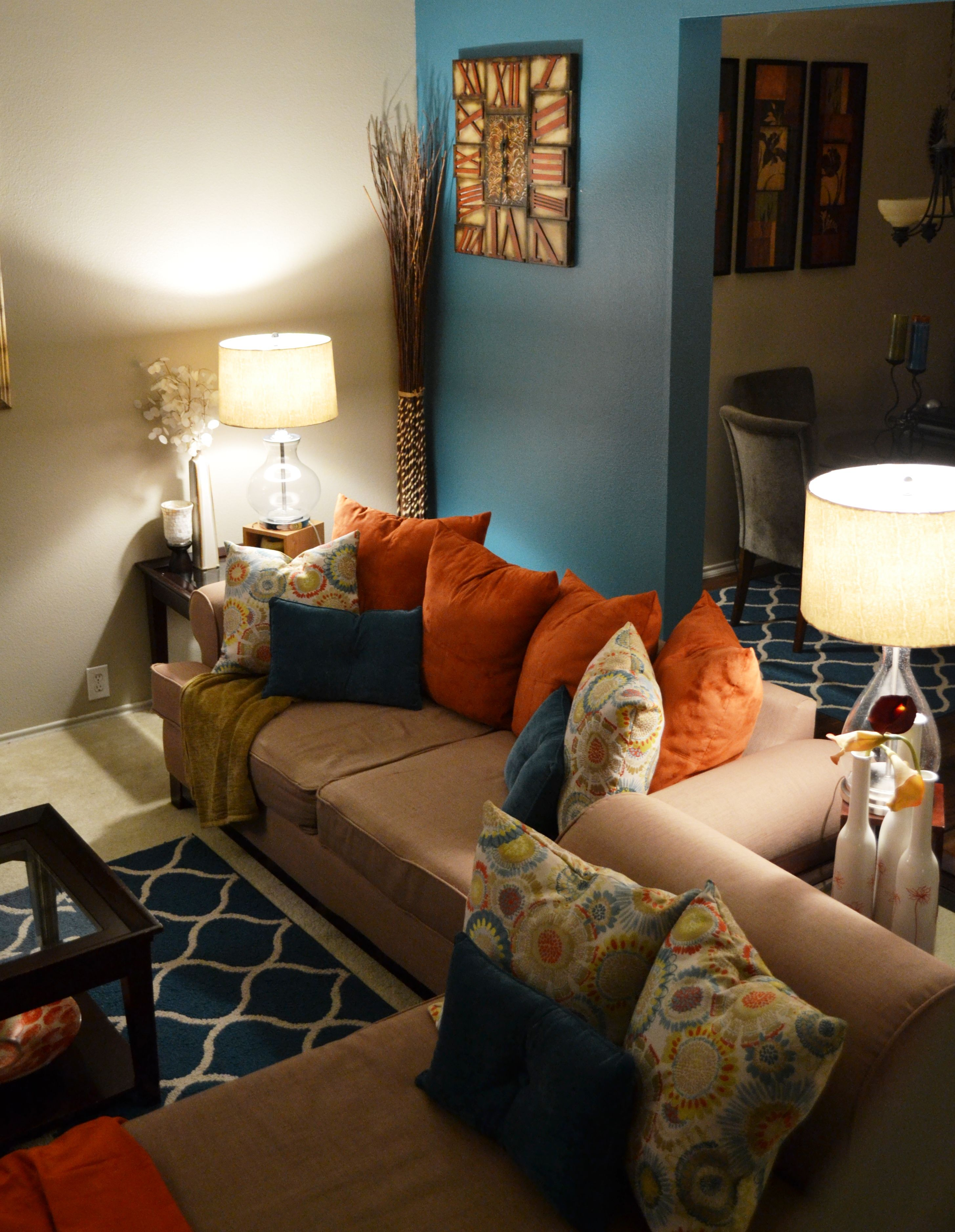 living room neutral walls with teal or orange accent wall - Brown And Orange Bedroom Ideas