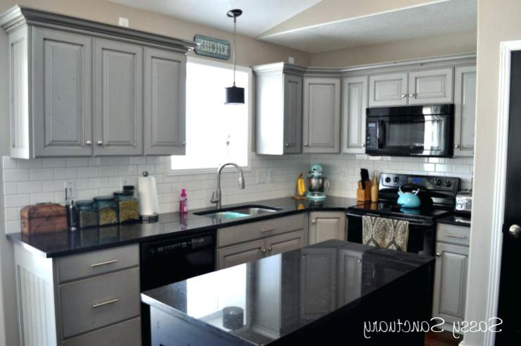 Gray Kitchen Cabinets With Black Counter Google Search Kitchen Cabinets With Black Appliances Black Appliances Kitchen Black Countertops