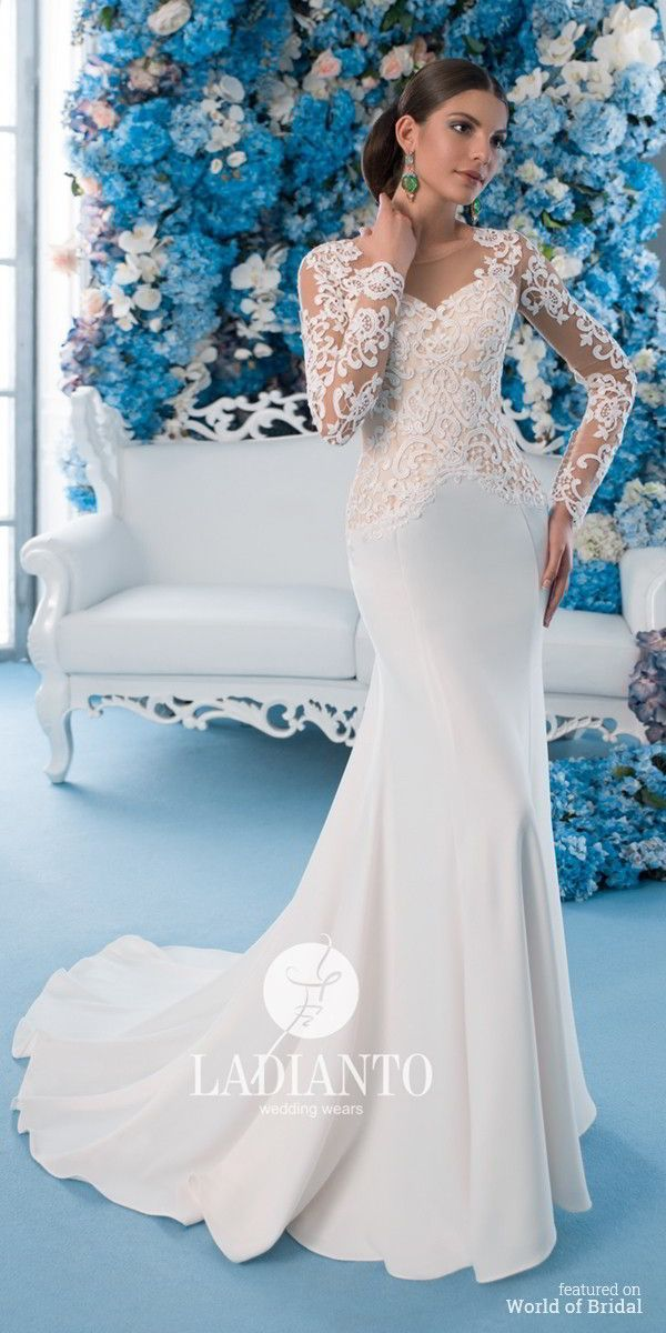 A mermaid silhouette wedding dress. The skirt is made of crepe, with ...