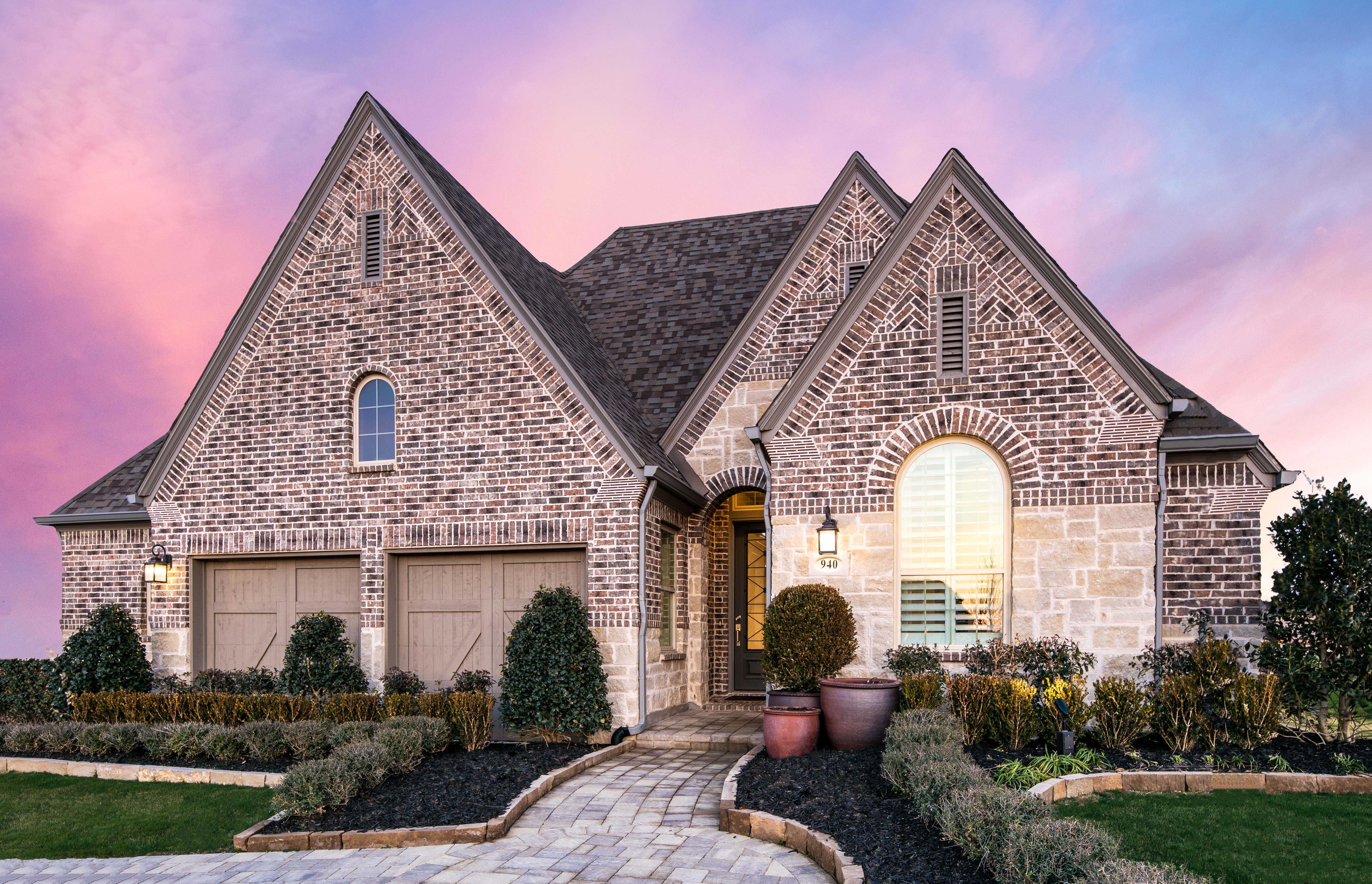 Front in highland homes 554 plan at 940 shooting star