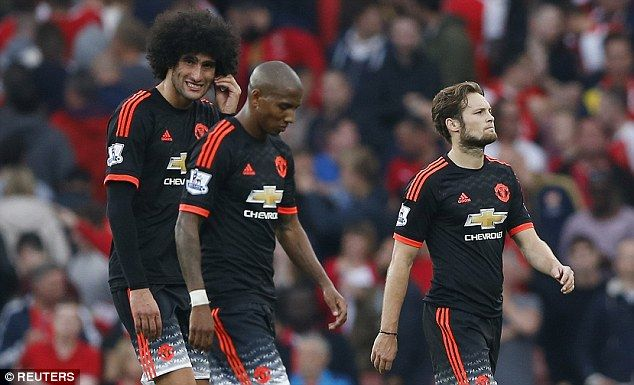 Marouane Fellaini (from left), Ashley Young and Daley blind trudge off the pitch after their 3-0 loss to Arsenal