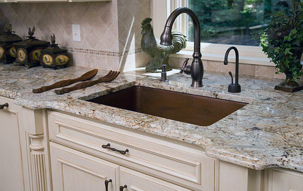 What color countertops go with cream cabinets for Cream colored granite countertops